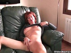 Redheaded grown-up mom plays give her nipples added to pussy