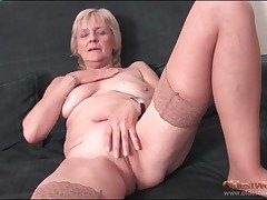 Granny strips just about stockings and fingers pussy