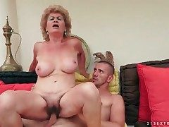 Puckered granny with big globes rails her man