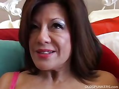 Sexy mature lady plays with her moist pussy